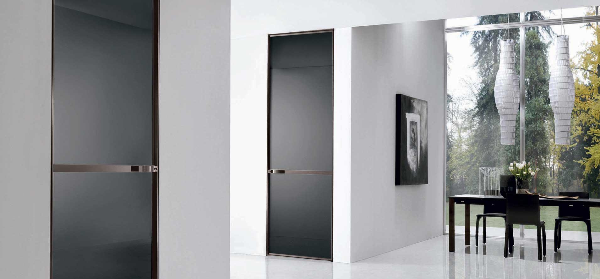foto del progetto porte modello WAVE, porta in vetro con profili in alluminio, con movimento tira e spingi per la ditta F.LLI LONGHI
