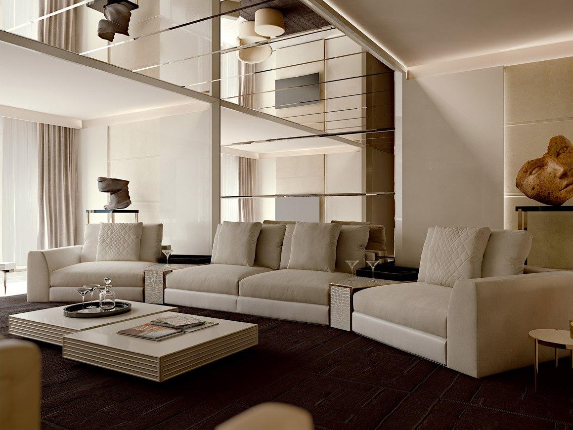 foto dell'interno appartamento di Montecarlo inquadrata area living con divano e tavolini FENDI, il progetto delle boiserie e dello specchio che corre anche sul soffitto è di cattaneodesign